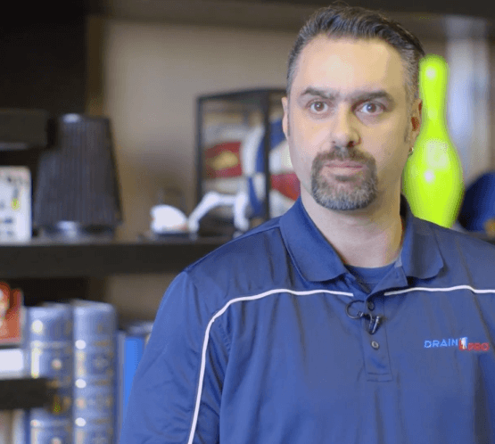 Drain Pro Plumber looks at the camera before answering a question for a video interview.