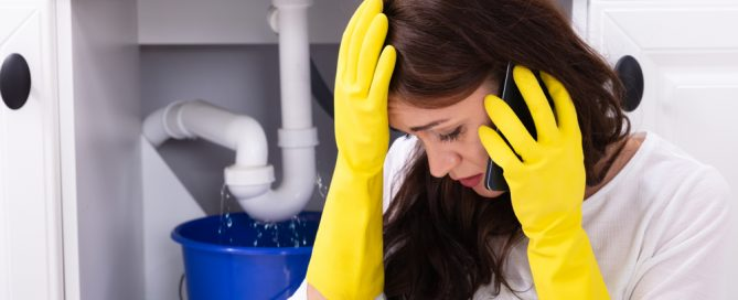woman overwhelmed with plumbing emergency calls plumber