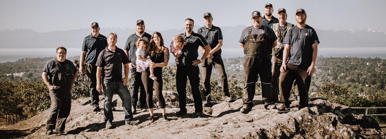 Drain Pro Plumbing Team standing on a rock overlooking Victoria, British Columbia