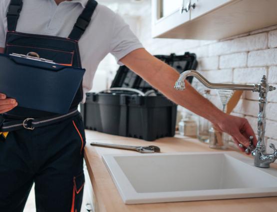 professional plumber assessing the kitchen skink plumbing system
